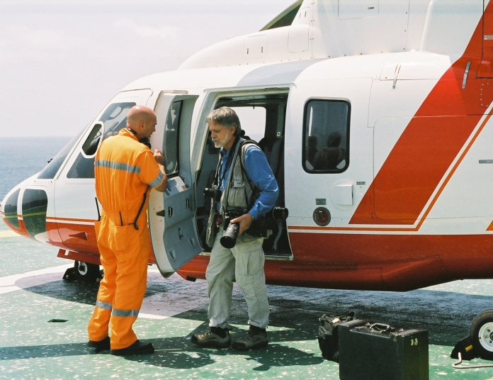 Wayne Eastep preparing for aerial photography of an FPSO offshore production site Angola