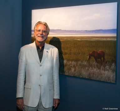 Documentary Photographer Wayne Eastep with his print at the Arthur Sackler gallery at the Smithsonian in Washington, D.C.
